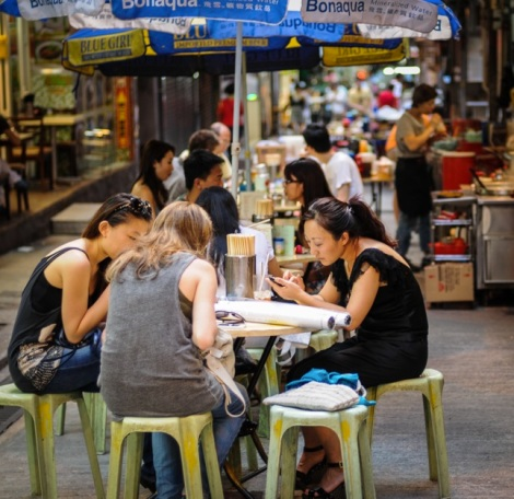 quintessentially HK 1 - people eating on the street