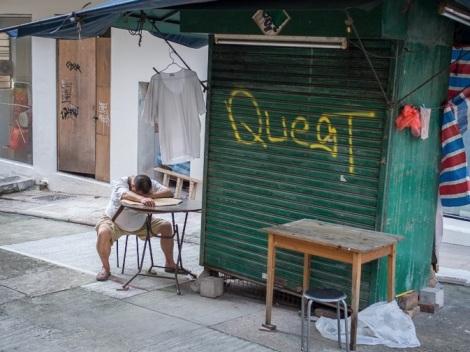 Sleeping shop vendor in Sheung Wan